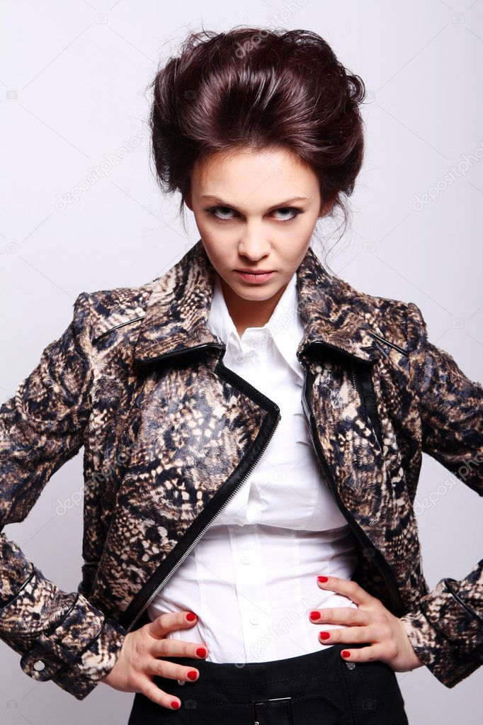 Attractive woman in leather jacket on gray background — Stock Photo #5841831