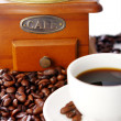 Stock Photo: Old coffee grinder with white cup