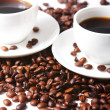 Coffee beans with white cups - Stock Photo