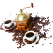 Old coffee grinder with white cup - Stock Photo