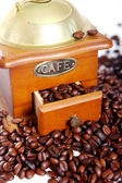 Old coffee grinder with white cup — Stok fotoğraf