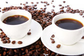 Coffee beans with white cups — Stok fotoğraf