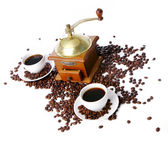 Old coffee grinder with white cup — Stock Photo