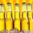 Bottles of beer with abstract background — Stock Photo