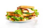 Deliciosos sanduíches no prato — Fotografia Stock