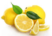 Fresh yellow lemons on white background — Stock Photo