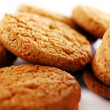 Fresh and tasty oat biscuits with cinnamon sticks — Stock Photo