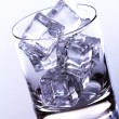 Glass filled with ice cubes — Stock Photo