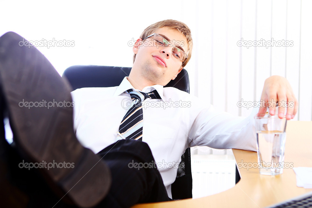 Young businessman having rest in his office  Stock Photo #6331155