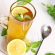 Cup of hot mint tea - Stock Photo