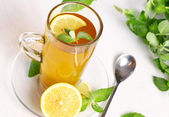 Cup of hot mint tea — Stock Photo