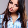 Young and beautiful woman in striped blouse — Stock Photo