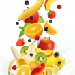 Lot of different fruits falling into milk — Foto de Stock