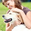 Young woman with her dog — Stock Photo