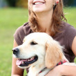 Young woman with her dog - Stock Photo