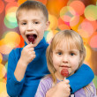 Children eating candy — Stock Photo