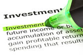 'Investment' highlighted in green — Stock Photo