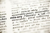 'Misery' - dictionary definition vignette — Stock Photo