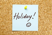 Blue sticky note 'Holiday!' — Stock Photo