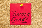 Red sticky note 'You are Fired!' — Foto Stock