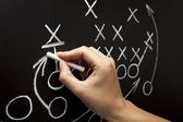 Man drawing a game strategy — Stockfoto