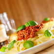 Pasta rigatoni on the white plate - Stock Photo