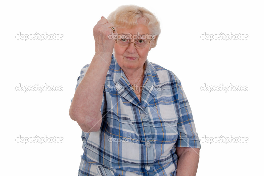 Elderly woman raising her fist - isolated  Stock Photo #5908420