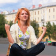 Meditating young ginger woman — Stock Photo #5516574