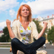 Meditating young ginger woman — Stock Photo #5527245