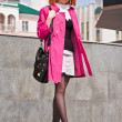 Beautiful ginger-haired woman in pink coat — Stock Photo
