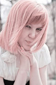 Portrait of a pink-haired woman — Stock Photo