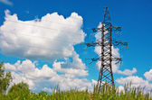 High voltage lines and blue cloudy sky — Foto de Stock