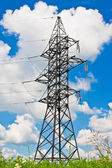 High voltage lines and blue cloudy sky — Stock Photo