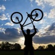 Cycling silhouette sunset success - Stock Photo