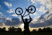Cycling silhouette sunset success — Stock Photo