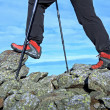 Hiking legs in mountains — Stock Photo