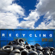 Recycling container and tires - Stock Photo