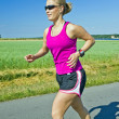 Running woman with music — Stock Photo