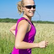 Running woman in summer nature, motion blur — Stock Photo