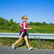 Running woman in summer country nature — Stock Photo #6463785