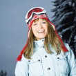 Happy woman snowboarder when snowing — Stock Photo