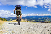 Riding a bike in mountains — Stock Photo