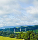 Wind turbines in mountains — Stock Photo