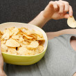 Man eating chips — Stock Photo