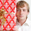 A man trying to guess a present — Stock Photo #5922550