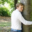 A man hugging a tree — Stock Photo #5922972