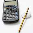 Calculator and pencil — Stock Photo