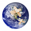Stock Photo: Wounded earth with bandaid