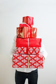 Presenting alot of gifts — Stock Photo