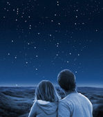 Couple under starry sky — Stock Photo